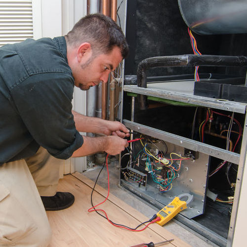 A Technician Checks an HVAC System.