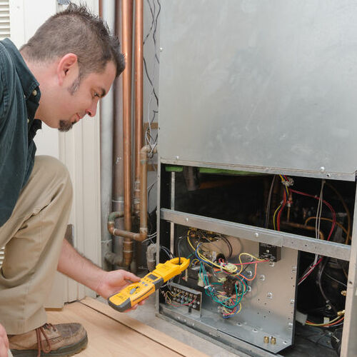 A Technician Tests and AC Unit.