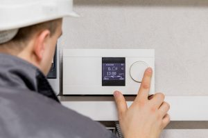 Man Working On Thermostat